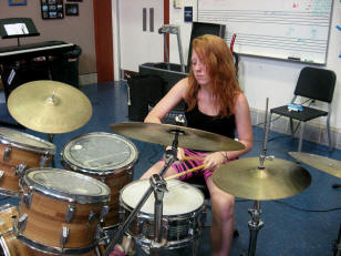 Gril playing drums