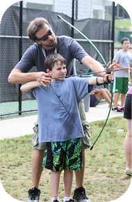 Young boy trying archery